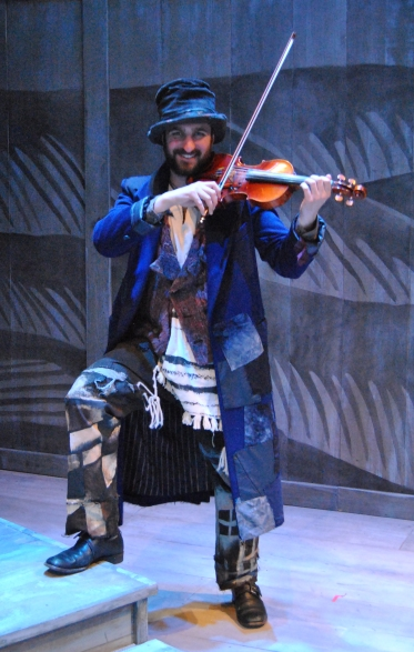 The Fiddler during a rehearsal break (photo credit: Sarah Strange)