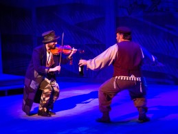 "Tevye and The Fiddler dancing in the ""Street Scene"" (photo credit: Tom Klingele)"