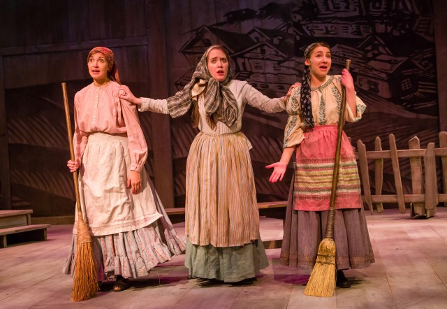 "Tzeitel (Rachel Holmes) pretending to be Yente during the song ""Matchmaker"" while surrounded by Hodel (Fiorella Fernandez), and Chava (Libby Zabit)<br>photo credit: Tom Klingele)"