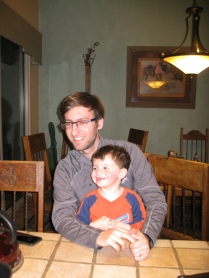 Uncle Jeremy and Ari watching Aunt Anya make chocolate cake.